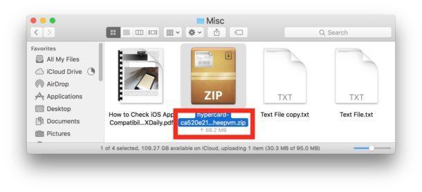 Stato di caricamento del file di iCloud Drive mostrato sotto le icone nel Finder